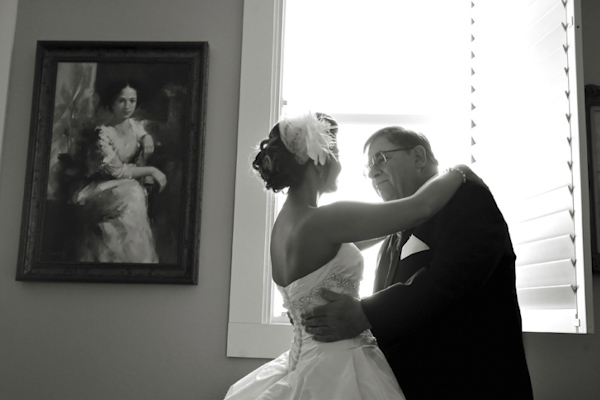 sweet black and white photo of bride hugging father before ceremony - fine art wedding photo by top Dallas based photographer Paul Ernest