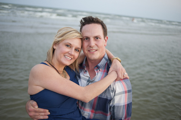 portrait of smiling bride and groom-to-be - waterfront engagement photo by Houston based destination wedding photographer Adam Nyholt