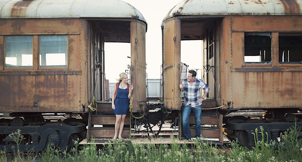 creative engagement session with stylish couple in old train yard - vintage, antique train cars - photo by Houston based destination wedding photographer Adam Nyholt