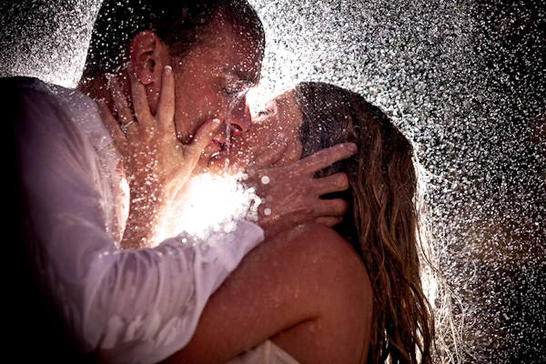 http://junebugweddings.com/img/photobug/june2010/romantic-backlit-photo-couple-kissing-passionately-in-rain-wedding-photo-by-south-africa-photographer-yvette-gilbert.jpg