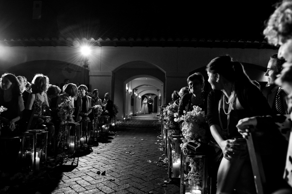 gorgeous black and white wedding photo of guests anticipating the bride's walk down the aisle - night photography, outdoor wedding ceremony photo by Houston and destination wedding photographer Morgan Lynn