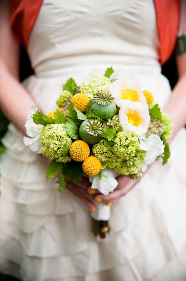 green, yellow and white floral bouquet of green viburnum, craspedia, angelica, poppies, sweet peas, ranunculus, and poppy pods, vintage inspired anniversary photo by top wedding photographer Laurel McConnell Photography
