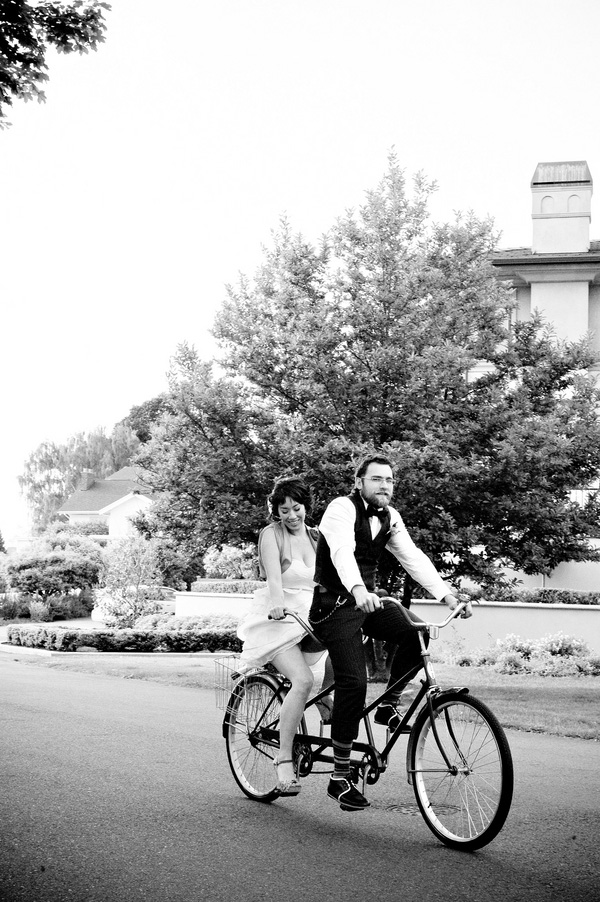 hip vintage inspired anniversary portraits in Queen Anne Seattle with vintage Schwinn tandem bike, photo by top wedding photographer Laurel McConnell Photography