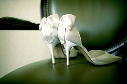 Image by Mel Barlow Photography, bow backed white wedding shoes