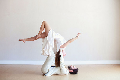 Acro Yoga engagement photos by Kiera Eve Photography via JunebugWeddings,.com