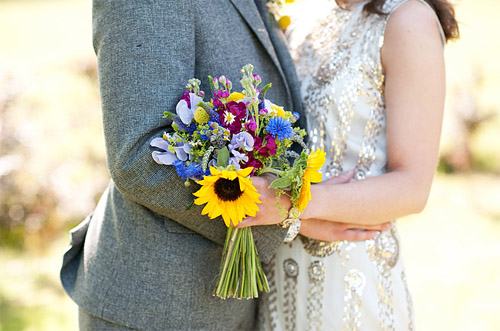English garden inspired flowers with Jenny Packham gown; photos by Dominique Bader | Junebug Weddings