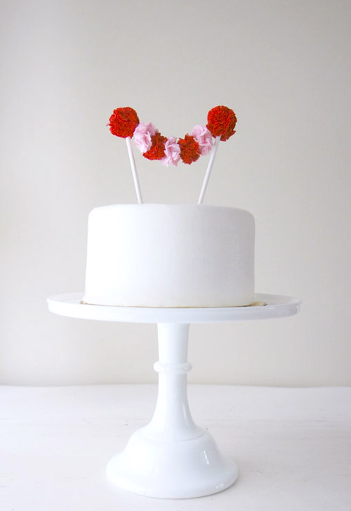 paper pom pom wedding decor and wedding cake toppers from Potter and Butler on Etsy.com