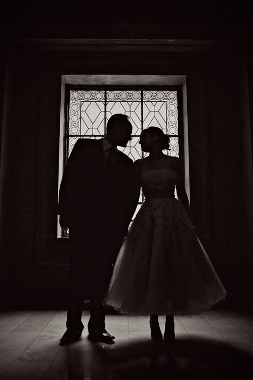 Silhouette wedding portrait at San Francisco City Hall, photo by Paco and Betty