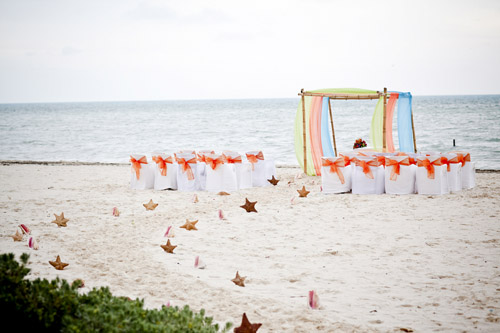 colorful tropical beach wedding at Excellence Playa Mujeres All-Inclusive Resort in Cancun, Mexico - photos by JAGstudios | via junebugweddings.com