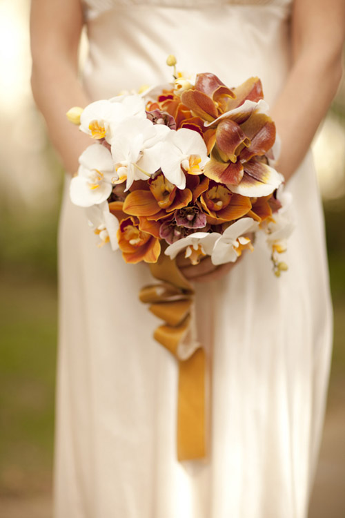orange and cream fall orchid wedding bouquet by Louloudi Design, photo by Allyson Magda | junebugweddings.com