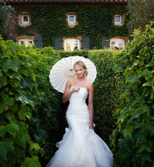 summer bride with a parasol - photo by Catherine Hall Studios | via junebugweddings.com