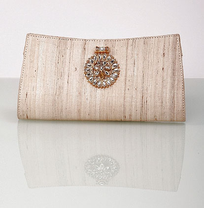 ivory raw silk wedding clutch by Lukab and Motwani