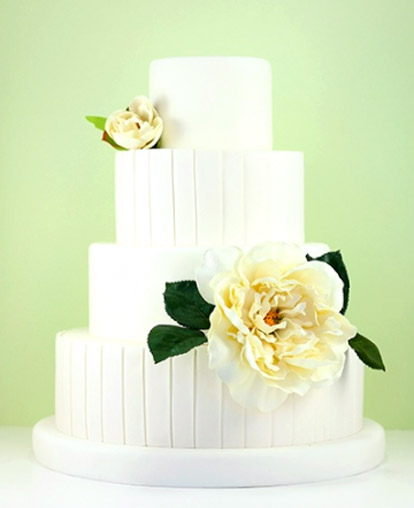Beautiful white modern fondant wedding cake with pretty floral decoration from Eat Cake Be Merry