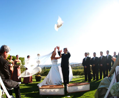 Releasing doves during an outdoor wedding ceremony, image by GH Kim Photography