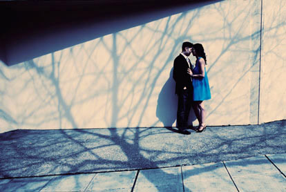 Engagement portrait with dramatic tree shadows by John and Joseph Photography