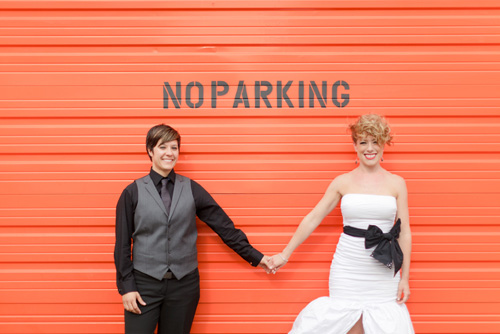 colorful orange, green, black and white same-sex wedding at the Russell Industrial Center in Detroit, Michigan, photos by Alli McWhinney