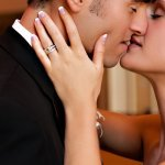 Steamy wedding photo of bride and groom kissing by A Truth be Shown