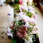 assorted bouquets by window - charming Hudson Valley NY wedding photo by top New York wedding photographers Belathee Photography