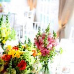 light pink, yellow and red floral centerpieces - charming Hudson Valley NY wedding photo by top New York wedding photographers Belathee Photography
