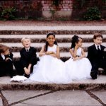 Dressed-up flower girls and ring bearers  - Wedding Photo by Bradley Hanson