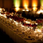 Romantic candle-lit and rose wedding reception centerpieces  - Wedding Photo by Bradley Hanson