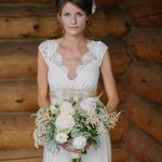 Bride in vintage wedding gown with white and cream bouquet - wedding photo by Michigan-based wedding photographers Bryan and Mae