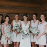 Bride and bridesmaids group portrait with rustic charm - wedding photo by Michigan-based wedding photographers Bryan and Mae