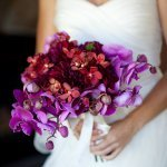 Beautiful bridal bouquet in purples and dark pinks - wedding photo by Catherine Hall Studios