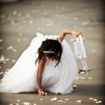 young girl picking up flower petals - wedding photo by top Orange County, California wedding photographers D. Park Photography