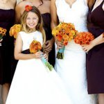 flower girl holding bouquet of flowers - wedding photo by top Orange County, California wedding photographers D. Park Photography