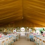 Stunning tented wedding reception with gold, blue and pink details - photo by Dan Stewart Photography