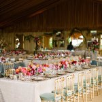 Beautiful tented wedding reception with teal, gold and pink color palette - photo by Dan Stewart Photography