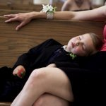 kid sleeping during ceremony - wedding photo by top Denver based wedding photographer Hardy Klahold
