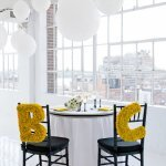 Oversized yellow initials as bride and groom chair decor | Photo by Image Singuli�re