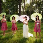 Bridal party with parasols - wedding photo by Kenny Nakai Photography