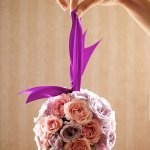 light pink and purple pomander with a purple ribbon - wedding photo by top Philadelphia based wedding photographers Langdon Photography
