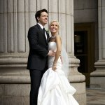 bride and groom together by a column - wedding photo by top Philadelphia based wedding photographers Langdon Photography