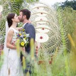 bride and groom kiss in field - wedding photo by top Philadelphia based wedding photographers Langdon Photography