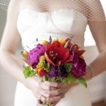 portrait of bride holding bouquet of flowers - wedding photo by top South Carolina wedding photographer Leigh Webber