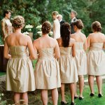 bridesmaids in short gold dresses watching ceremony - photo by San Francisco based wedding photographer Lisa Lefkowitz