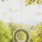 Hanging white floral wreath - Photo by The Schultzes