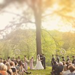 Sunny outdoor wedding ceremony photo by The Schultzes
