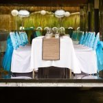 light blue ribbons tied on white back chairs in garden reception venue - traditional Indonesian wedding in Bali - photo by Portland wedding photographer Bunn Salarzon