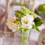Simple and pretty white, ivory and green floral arrangement - Photo by Emily Delamater