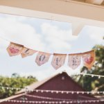 Rustic burlap Love sign with red hearts - Photo by Michelle Warren Photography