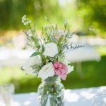 Pink and white rose table arrangement with organic greenery - Photo by Nordica Photography