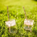 Majon jar drinking glasses with pink and white straws - Photo by Nordica Photography