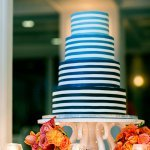 Blue and white striped, ombre wedding cake - Photo by Sarah Tew Photography