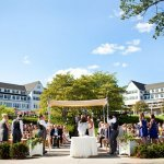 outdoor waterfront ceremony at sunny country club/ resort - preppy New York Sagamore resort wedding photo by New York wedding photographer Tracey Buyce