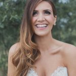Beautiful, happy bride wearing her hair loose and down - Photo by Whitewall Photography